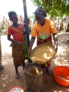 One of Gordon's neighbors sifting out the larger groundnut pieces to pound again.
