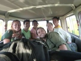 PCTs Amy, left; Zach, second-from-left; and Adam (behind me) in the Peace Corps Land Cruiser on the way to the NoPro Provincial House with current LIFE PCVs Chandra (eyes closed) and Nick (up front).