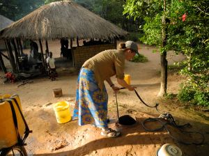 Me fetching water for the first time, at Ba Agatha and Ba Bernardi's well.