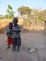"Agri and Katongo showing off their homemade ""motoka."""