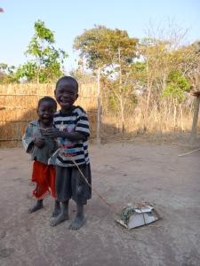 """Agri and Katongo showing off their """"motoka."""""""