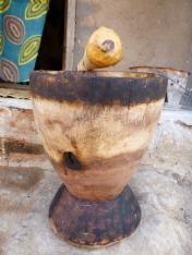 My ibende (mortar and pestle), with sticky mpundu fruit still on the pestle.