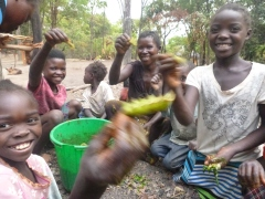 Norida, Precious, Lister, and Mavis hold up their cipumi harvest.