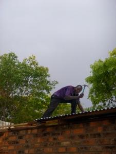Ba Evans, working on Ba Bernardi's new metal roof.