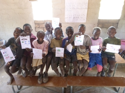 Mfuba schoolkids showing off their drawings.