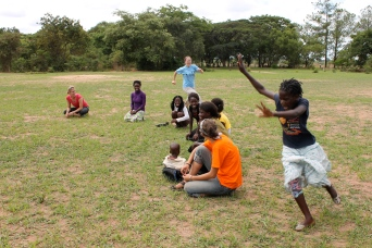 Duck, duck, goose, which we played upon arrival to kill time until our Zambian facilitators showed up. The girls have their own version of the exact same game, so it was great fun for all. Well, except that I could NOT catch these girls and found myself running hopelessly around after Matilda and two other girls before PCV Garrett took pity on me and ran slowly so I could take a break.