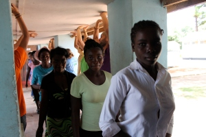 Patricia, right, and Harriet (behind her), of Mfuba Village, mildly terrified entering the lodge on Day 1.