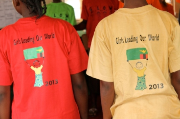 """Back view of the girls' GLOW shirts. Each """"pride"""" had a different color and chose their own name."""