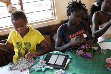 Fridah and Matilda sewing sanitary pads - a project the girls were really into.