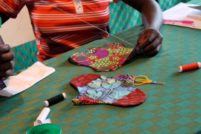 Patricia sewing sanitary pads. She and Harriet had never sewed before, so I got to teach them. My counterpart Ba Dorothy was much better at it though; in the end she finished the pads for them.