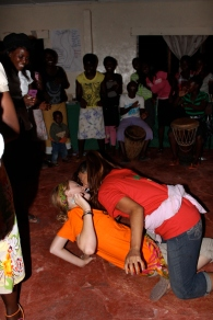 "Then PCVs Jasmine and Clara gave the dance a try. Clara, acting as the ""man,"" had to get the token out of Jasmine's mouth - using only HER mouth. The Zambians loved this!"