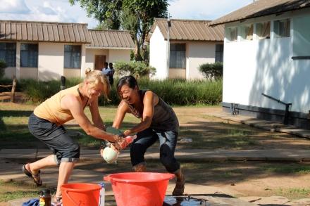 Garrett and Clara preparing to throw some water.