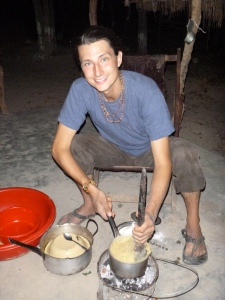 Samuel, displaying his best Zambian hospitality by cooking me ubwali at his site.