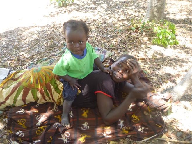 Ba Agatha, aka Ba Angata, aka Bana Brenda, aka Banakulu Ino, with her 2-year-old daughter, Gracious, aka Gile.