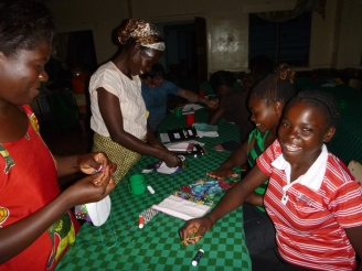 Ba Agness, Ba Dorothy, Harriet, and Patricia sewing citenge pads.