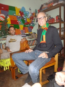 Steve, our PCVL (Peace Corps Volunteer Leader) at the NoPro house - and my predecessor in Mfuba village - shows off the Zambian flag scarf he got for our Christmas morning white elephant exchange. Zach's admiring him.
