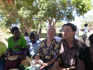 Eating ubwali at our Yuda Village going-away party. L to R: Ba Grace, Ba Margaret, me, and Samwell.
