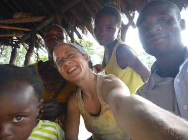 Clowning around with the Mutale family. L to R: Gile, Ba Agatha, me, Bwalya, and Webby. Notice Agatha playing with my braid. Women and kids of all ages love to just play with my hair, casually and without ever asking.
