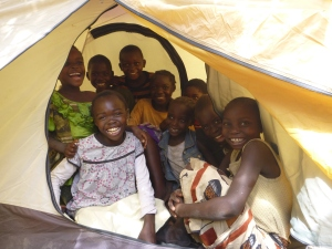 Nine young Mfubans piled into Adam's tent. They watched its construction with awe and were overjoyed to be allowed inside.