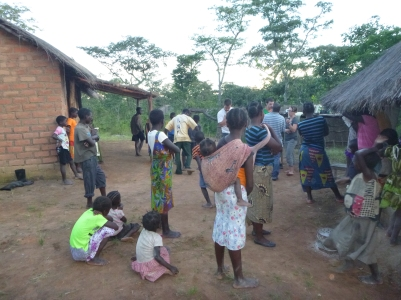 A crowd of Mfubans gather to watch FIVE muzungus - the most ever in the village at one time - when I hosted Second Site Visit for the new LIFE PCTs.