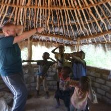 "My brother Lee, teaching the Mfuba kids ""the sprinkler"" dance."