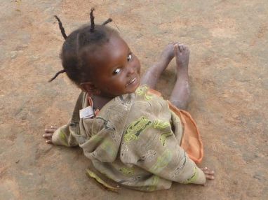 This photo shows possibly my very favorite hairstyle in Mfuba. It also marks the first time Melba smiled at me! (For most of my first year in Mfuba, she dissolved into sobs upon seeing me, but I've slowly won her over, and this photo shoot represented a very happy turnaround.)