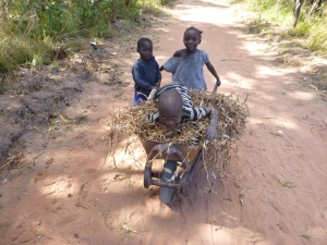 Agri, Annette, and Katongo (riding atop the beans).