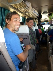 Zach and Samwell on a cushy bus between Solwezi and Mutanda - just before our hitching adventures really began.