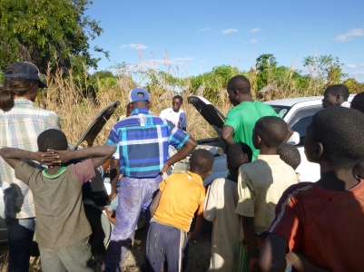 Villagers watch as we jump the battery.