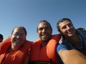 Me, Zach, and Samwell on the boat to Kalabo. (Notice the guys' sweet braids - my handiwork from the day before.)