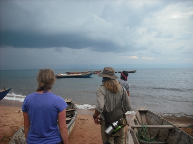 Tessa, Mark, and Luke watch a storm rolling in - right from the direction we needed to go to return to Mpulungu.