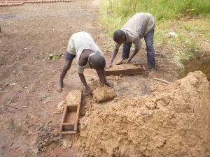 Stephen and Boyd making bricks.