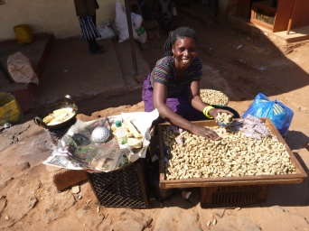 This woman sold us groundnuts and the last of her fried sweet potatoes - then kindly consented to a photo.
