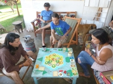 "Samwell, Zach, and Katie in an intense game of ""Settlers of Catan."" And I thought only the Northern PCVs were addicted to this game!"