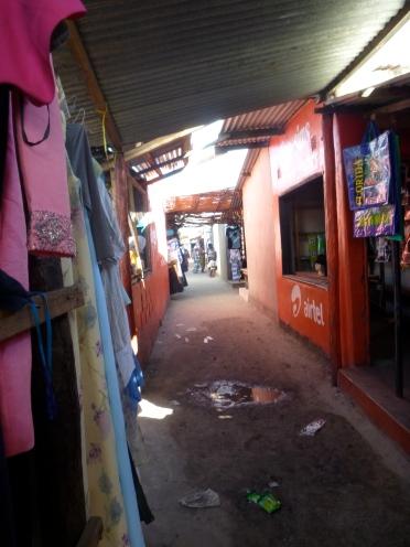 Narrow alley in Mongu's market.