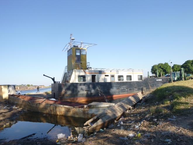 Long-beached ship in the Mongu Harbor.