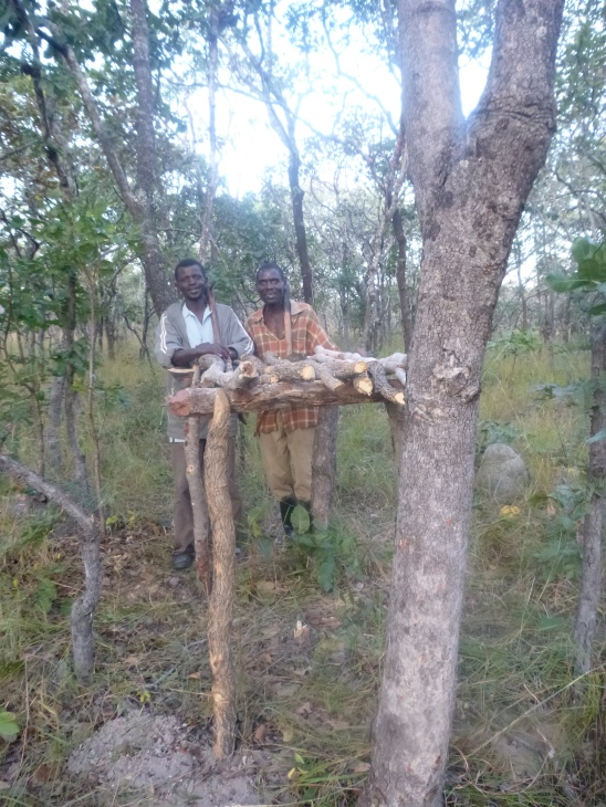 Ba Abel and Ba Allan showing off the stand atop which they will build their second mud-brick bee hive.