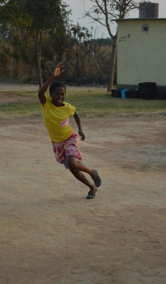 Aggie runs for a ball at Luwingu Camp GLOW.