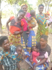 Ladies of Mfuba, posing in their ever-colorful outfits.