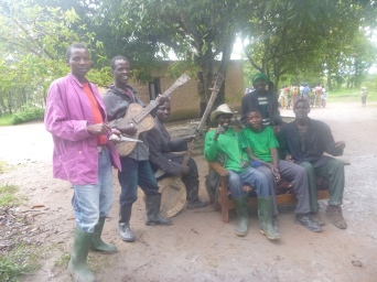 """The guys showing off their """"bush instruments"""" at Mwaba's wedding."""