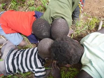 Katongo, Boke, Allan Jr., and Doris digging for inyense, an edible insect.
