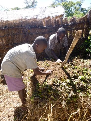 Bwalya and Boyd making compost.