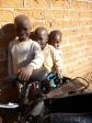Mwango, Iggy, and Milimo convince me to take the most prized of all photos: one of them with my fancy bike.