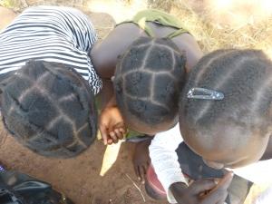 Three of my GLOW girls show off their braids. Left to right: Mwape, Mwango, and Chola.