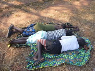 Mwango, Mwape, and Chola, fake-napping along the side of the road on the way to Camp GLOW. We did have to wait a little while for transport. But not THAT long!