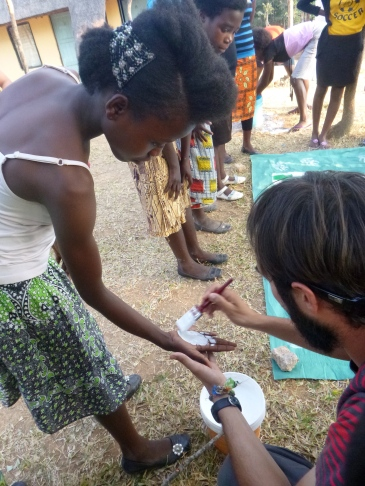 Jesse paints Abigail's hand.