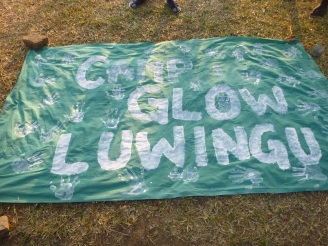 Handprints covering our homemade GLOW banner.
