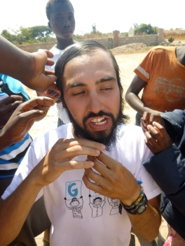 Jesse braids his beard while the girls take care of his hair.
