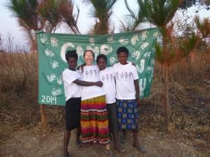 Mwape, me, Chola, and Mwango. It wasn't until I took them to Camp GLOW that I learned Mwape and Chola's English names: Gladys and Evet.