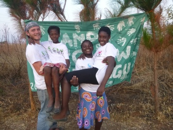Adam posing with Aggie (from his village), Mervis, and Nelly.